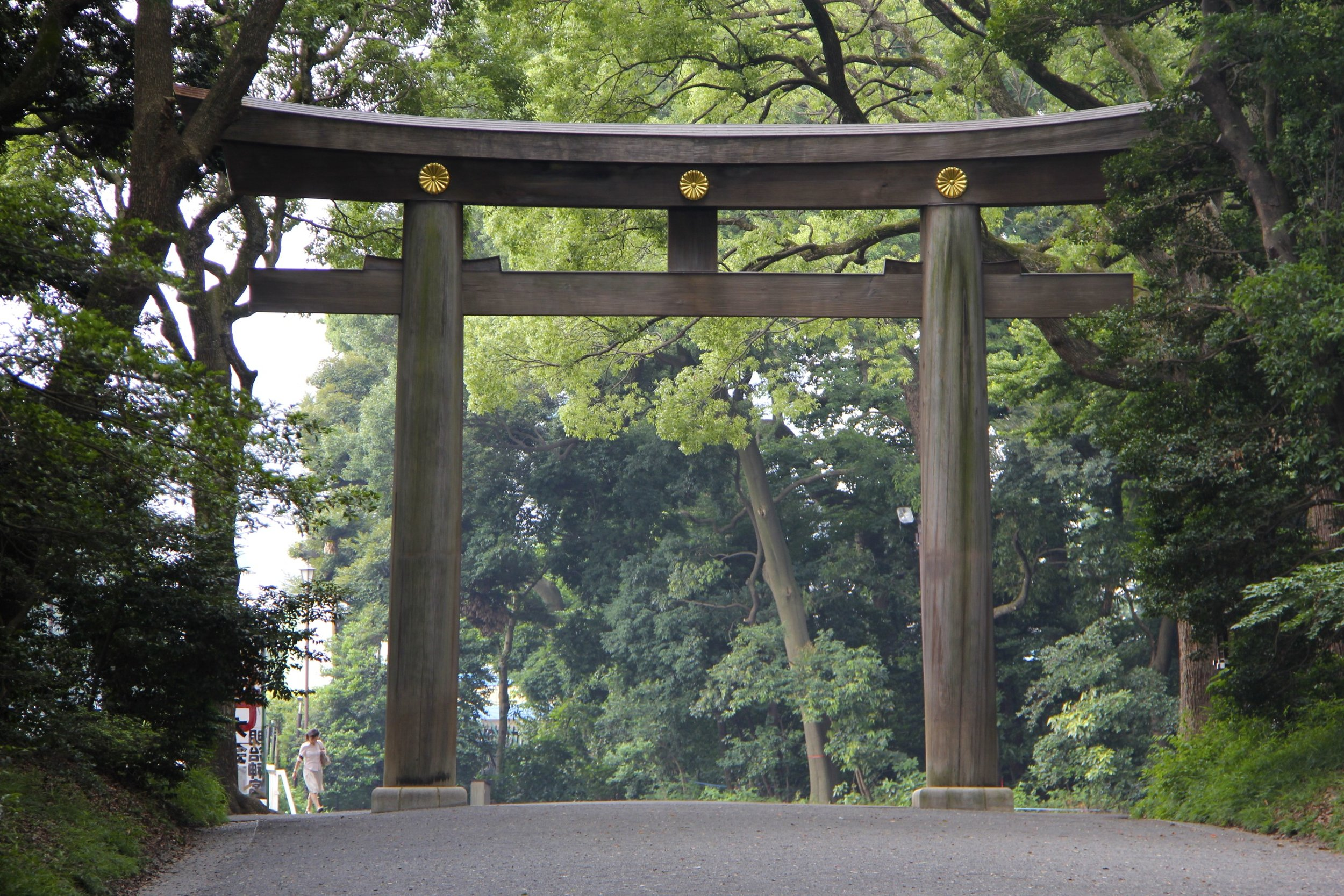 The Tori (gate)  leading to the Meiji Shrine complex.  Meiji Shrine is  located in Shibuya, Tokyo is the Shinto Shrine that is dedicated to the deified spirits of Emperor Meiji and his wife, Empress Shoken.
