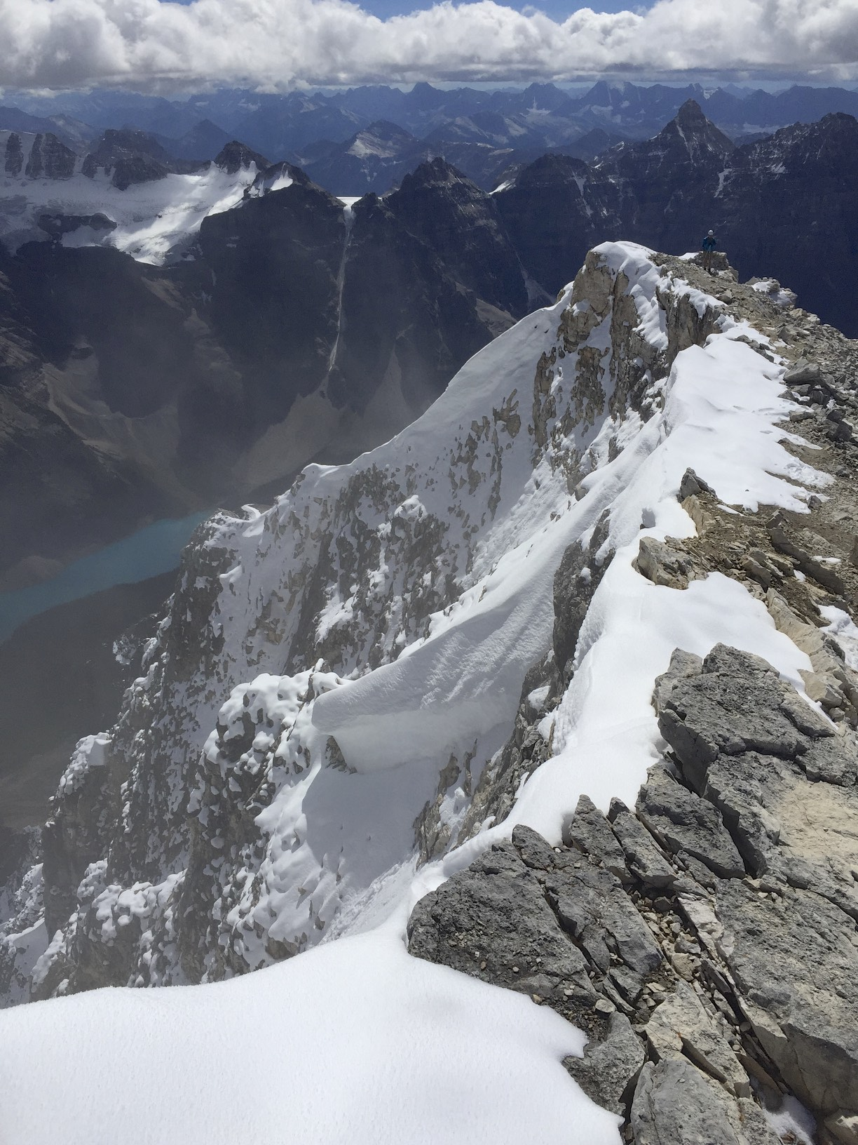 The summit ridge of Mt. Temple with Lake Moraine below