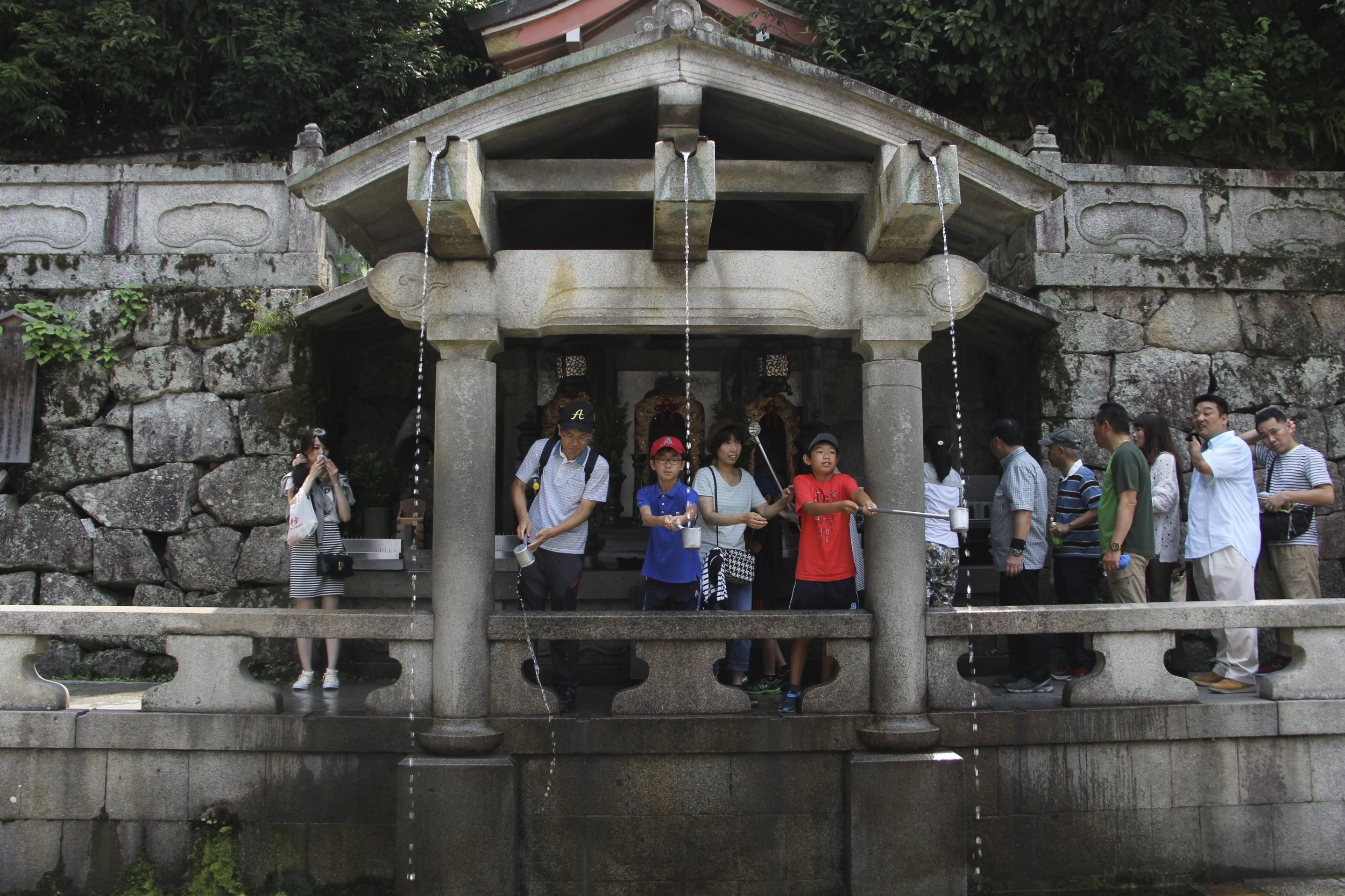 Beneath the main hall of the  Kiyomizu-dera  Temple is the Otowa waterfall, where three channels of water fall into a pond. Visitors can catch and drink the water, which is believed to have wish-granting powers.