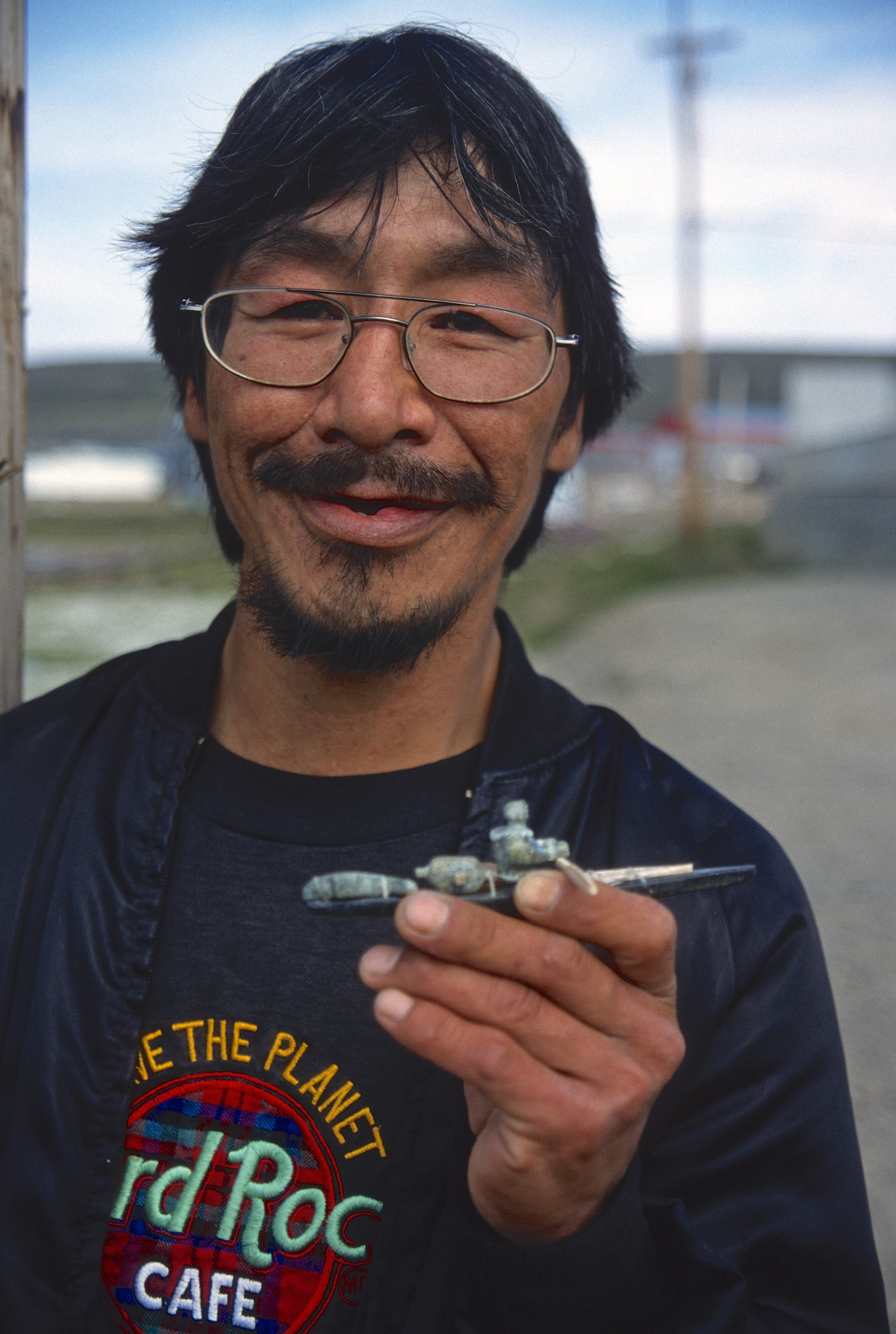 An Inuit carver with his creation