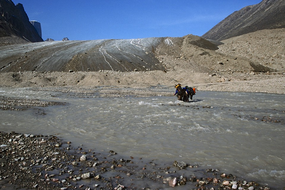 Fording the river flowing from the Turner Glacier