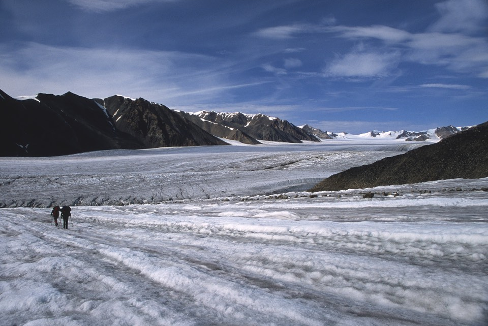 Massive Sermilik Glacier flowing from the centre of the island