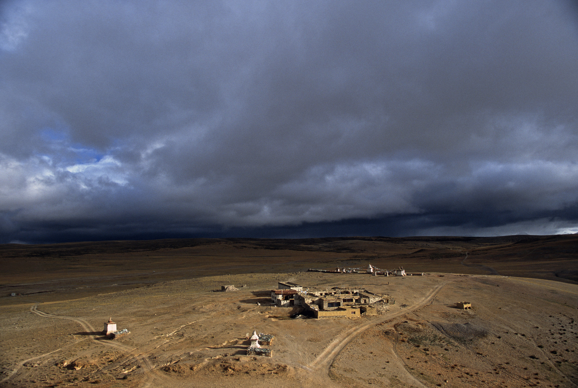 The stupas and a lone guesthouse on the hills overlooking Lake Manasarovar