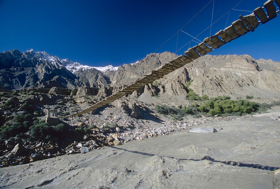 We drove from Skardu to Askole. The drive is 6-7 hours long and follows the Shigar River Valley. The road was blocked by a rock fall but the locals blasted the passage open. A bridge over the Braldu River near Askole.