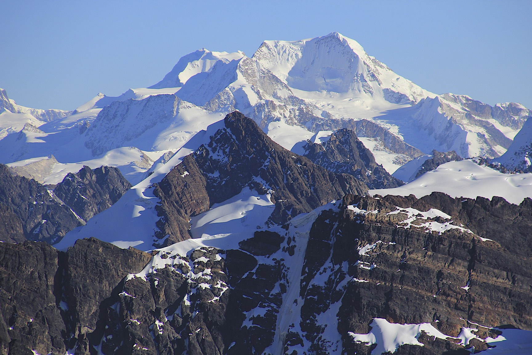 The large bulky mountain is Chachacomani 6,074m fromt the summit of Pequeno Alpamayo.