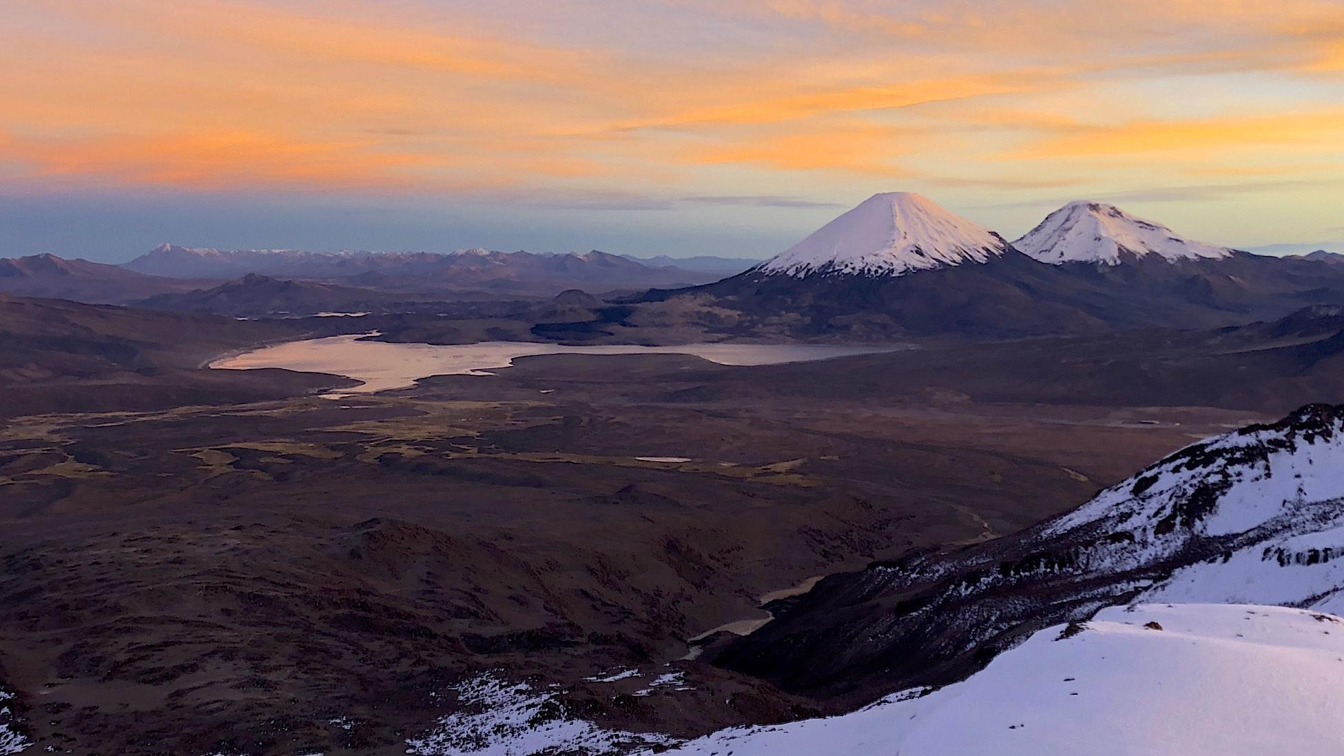 Volcanoes Parinacota and Pomerade and Chungara Lake in Chile from Acotango