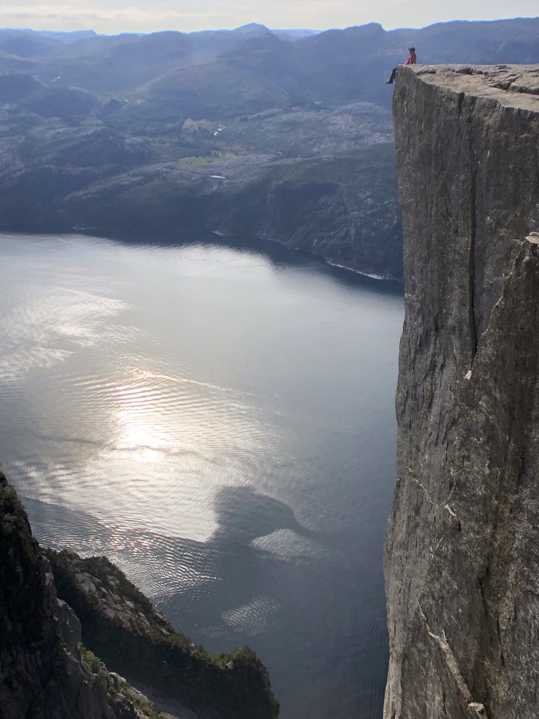 Sitting at the edge of a 600m drop on top of the Pulpit Rock near Stavenger