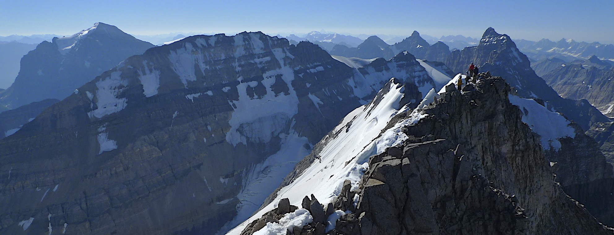 Mt. Temple on the left, Mt. Leroy in the centre and the summit ridge of Mt. Victoria
