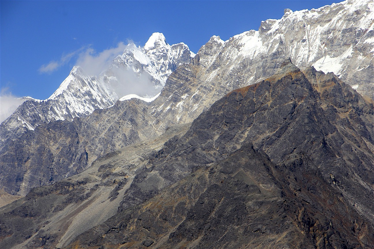 Yala Peak on the right (high point of the rocky ridge) and the Langtang Lirung group on the left.