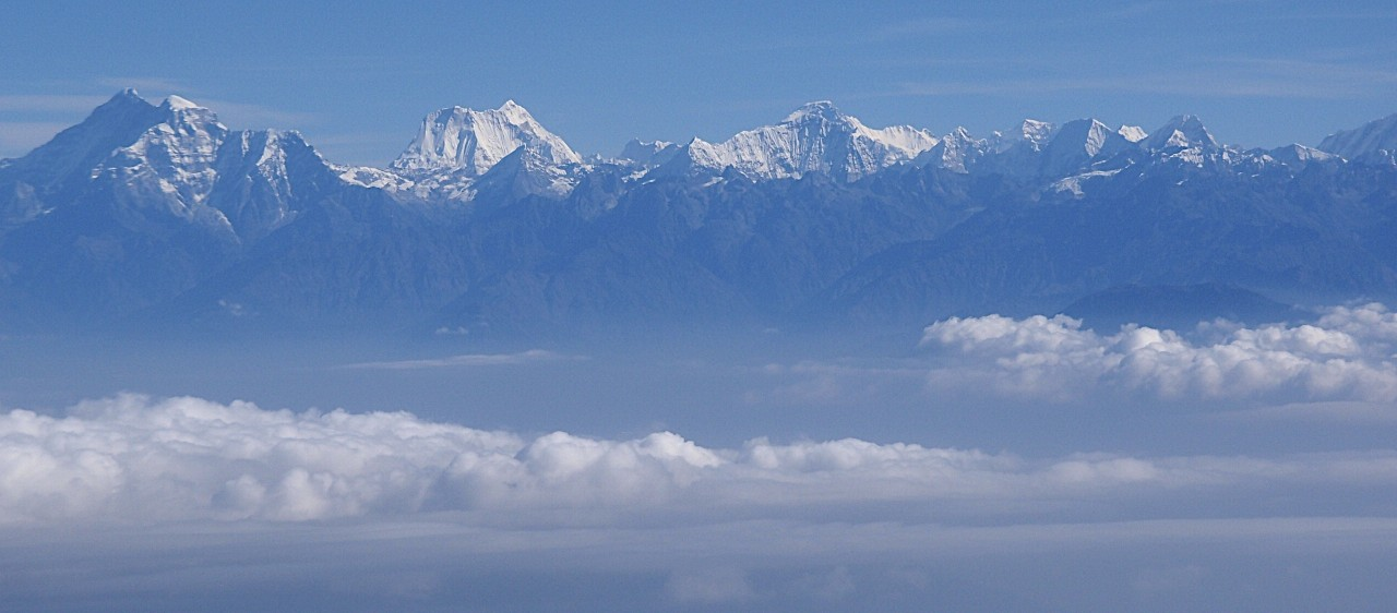 Rowaling Valley from the air. From Left to Right: Gaurisankar, Menlungtse, Kang Nachugo, the peaks of Rowaling. Our route followed this range from left to right.