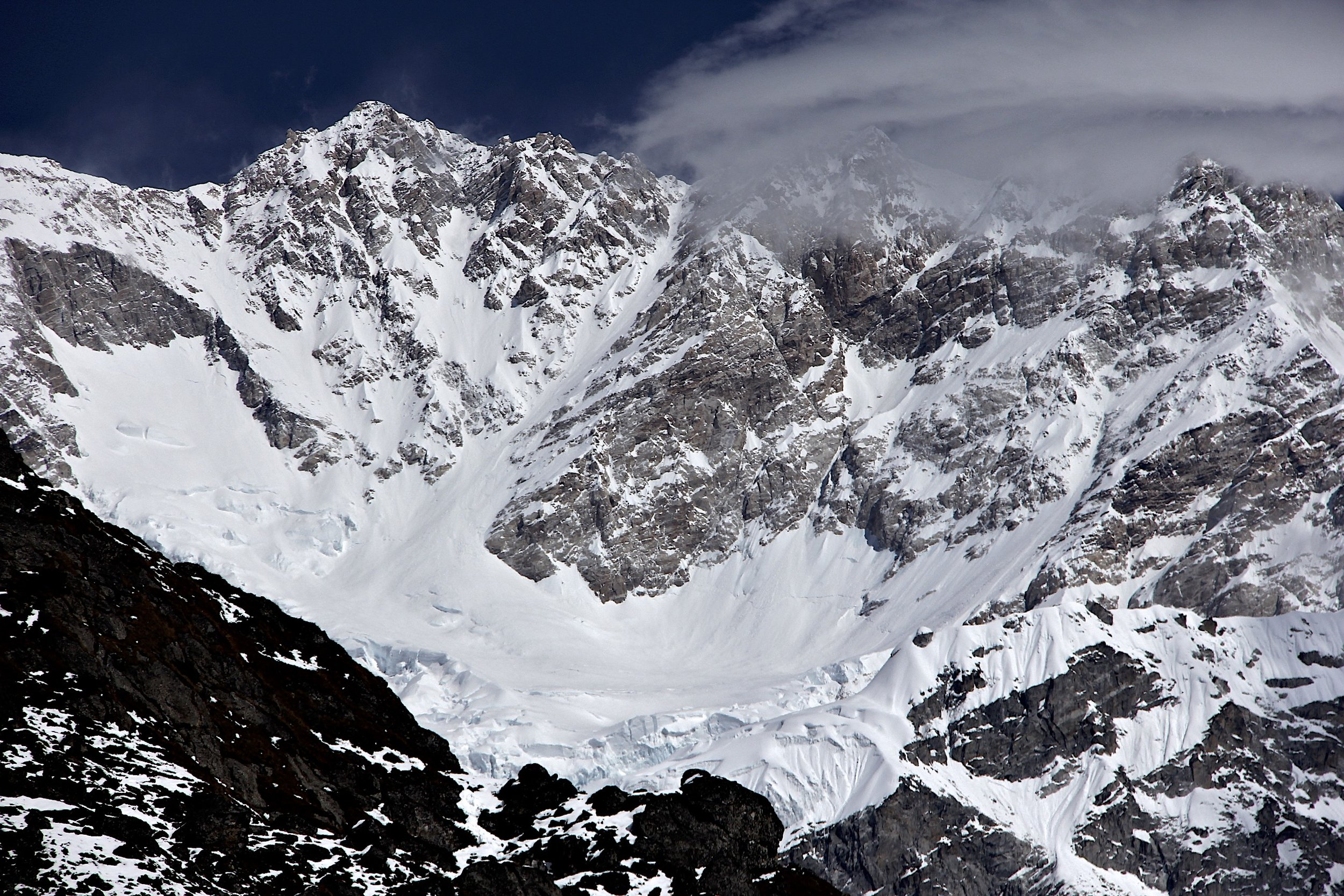 Kanchendzonga 8,586m (left), Kanchendzonga Central (in the clouds) 8,482m