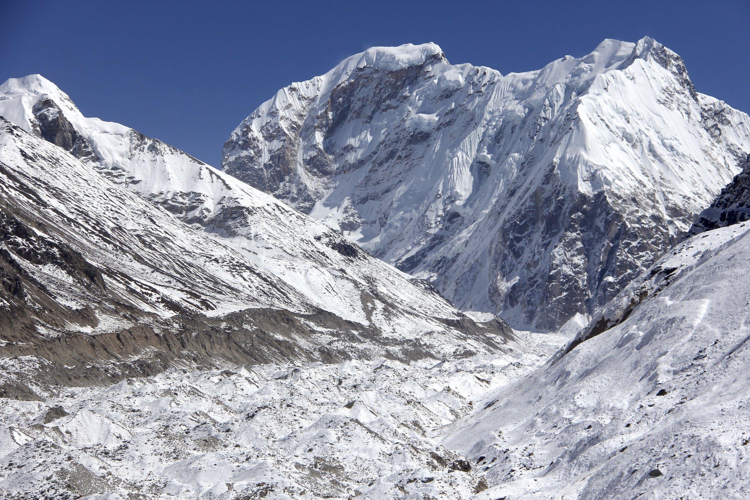 Tent Peak 7,362m and Nepal Peak 7,177m above the Kanchendzonga Glacier.