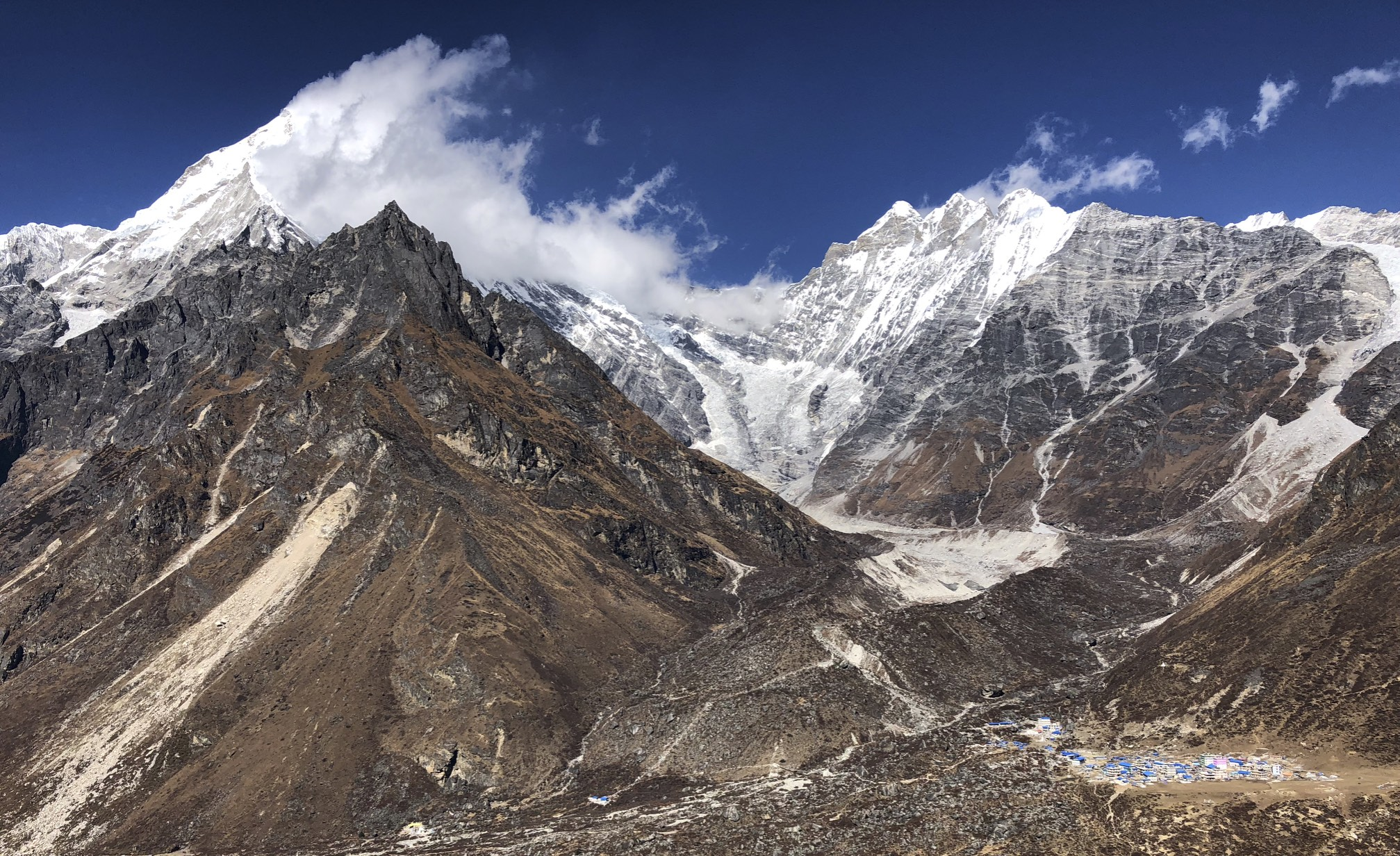 Hiking to the Ganjala Pass with Kinjang Gompa below.