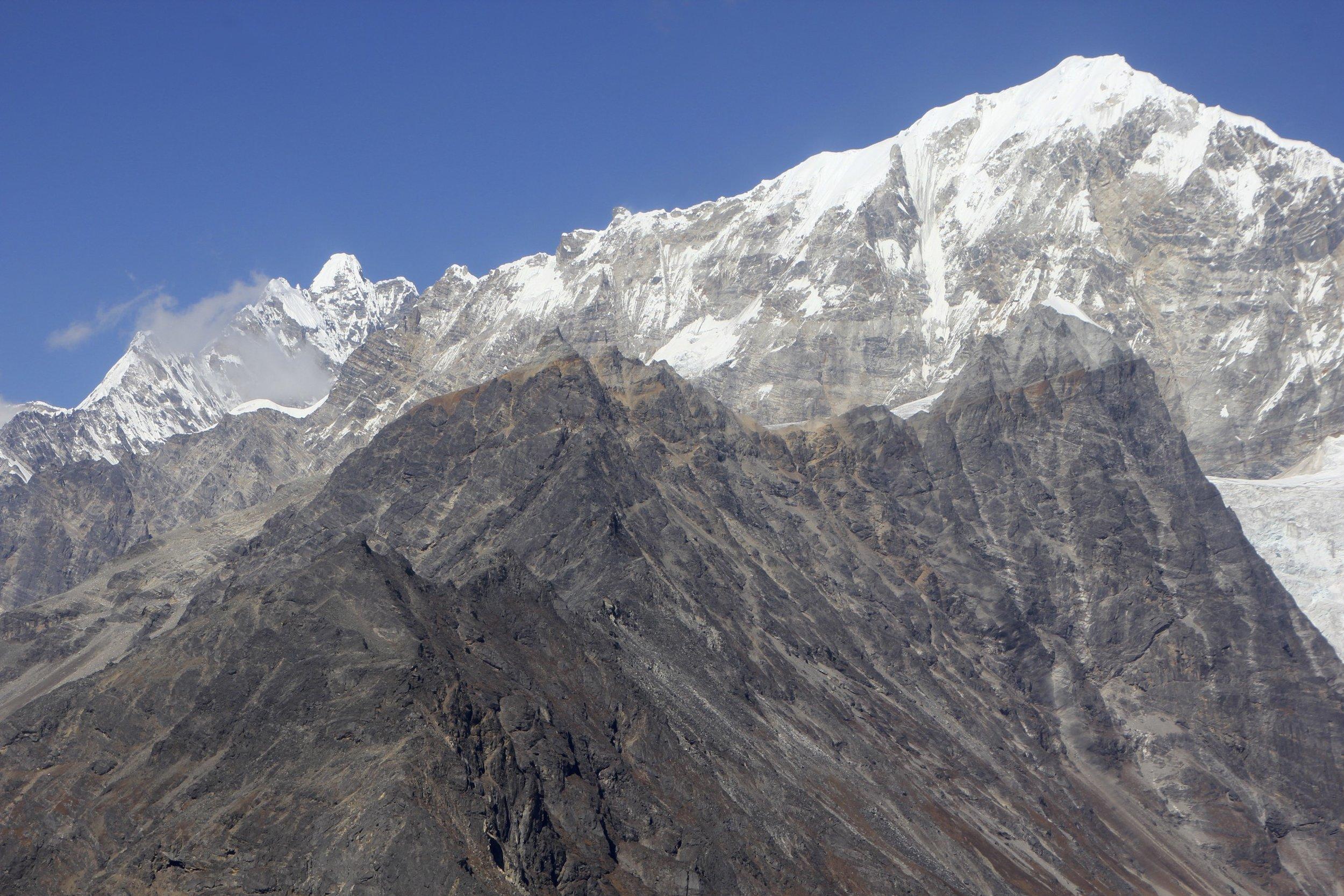 Yala Peak is the highest point along the rocky ridge