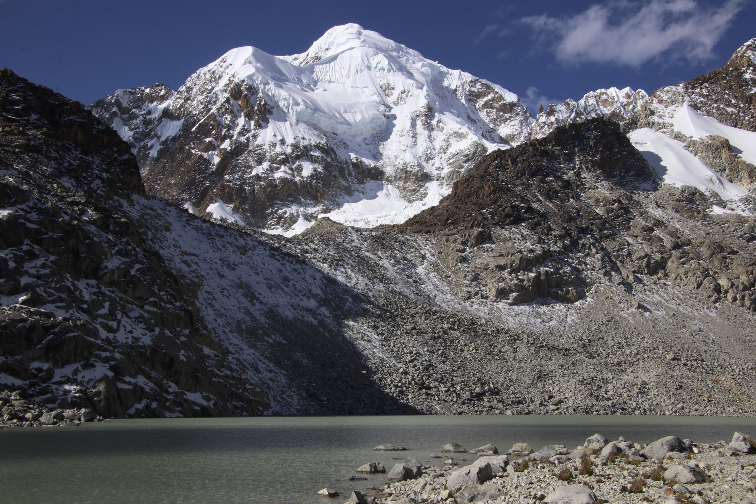 Laguna Glaciar and Illampu. Illampu is the most difficult mountain to climb in the entire range. The standard climbing route is on the opposite side of the mountain.
