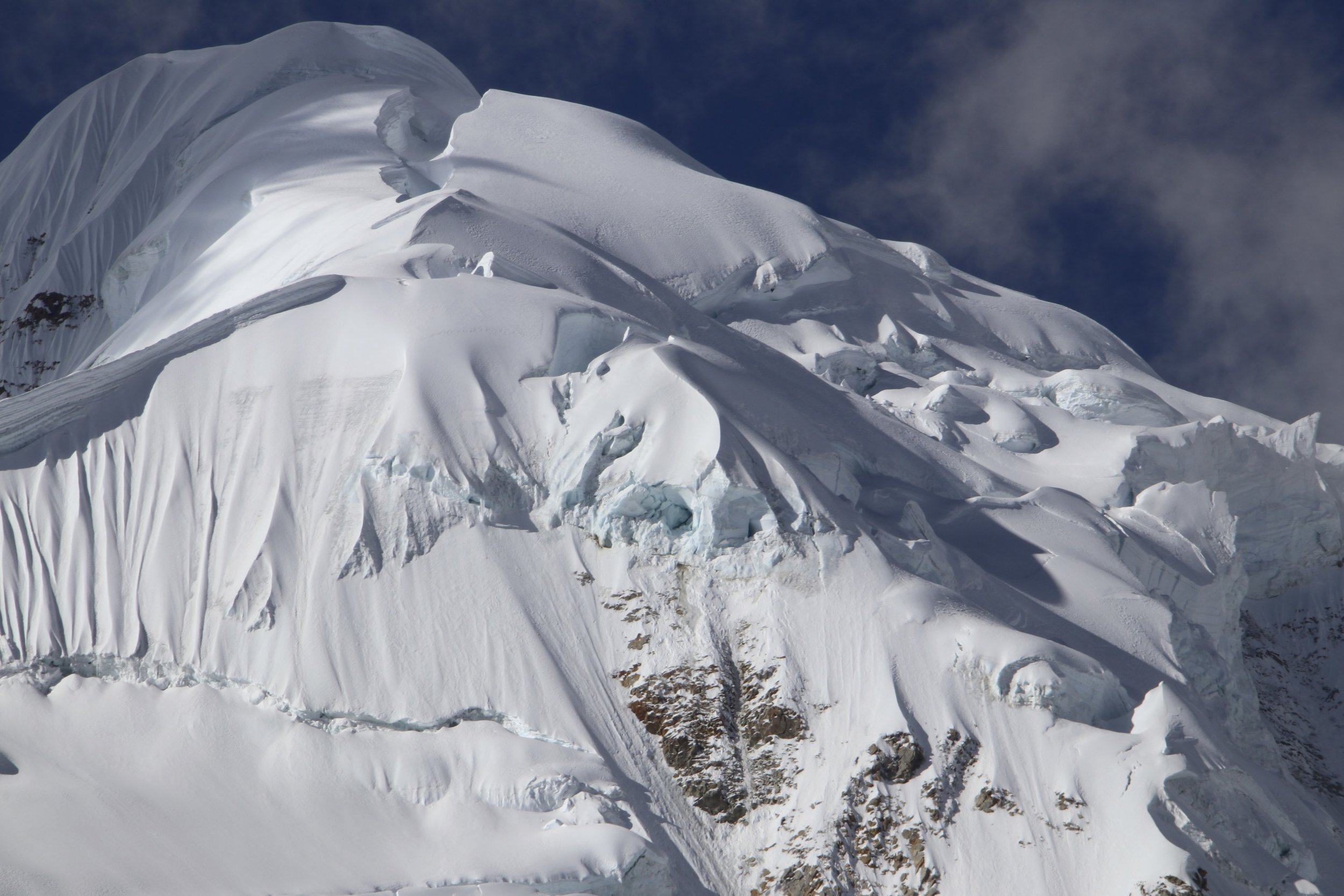 The upper section of Illampu. The glacial changes make the climbing more challenging,