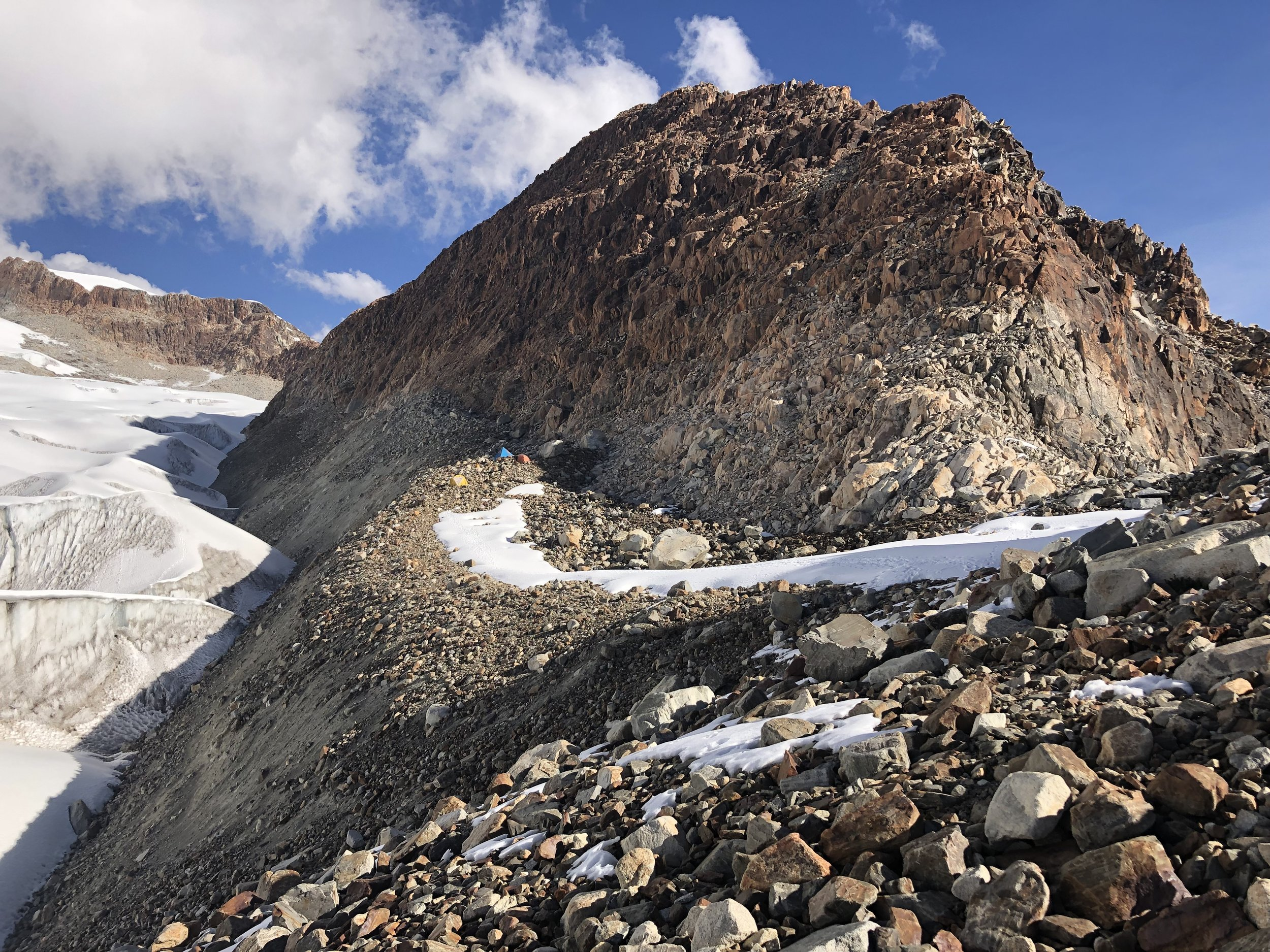 The high camp is on the edge of the high moraine. It is a fantastic spot with great views. There are a few flat platforms for tents.