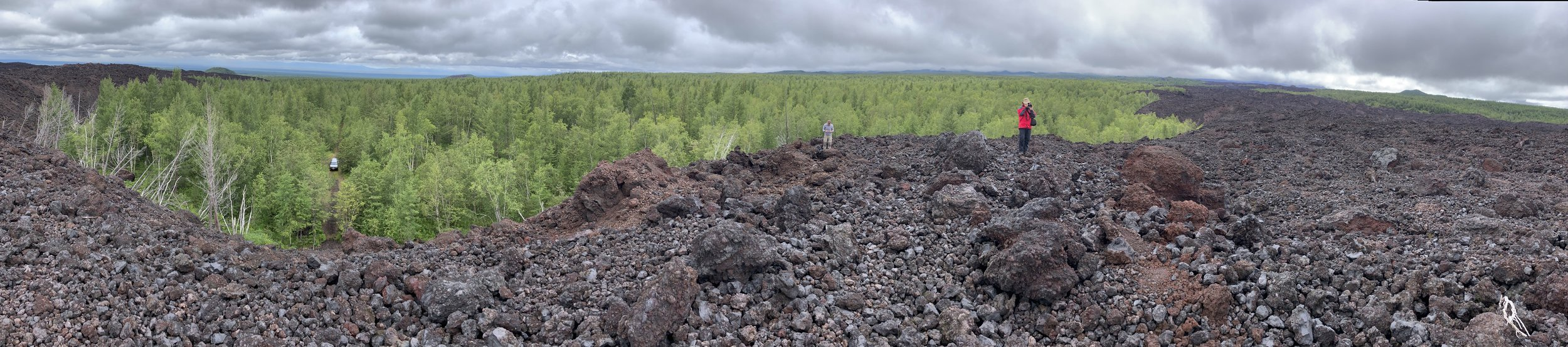 Marveling at the extensive lava flow.