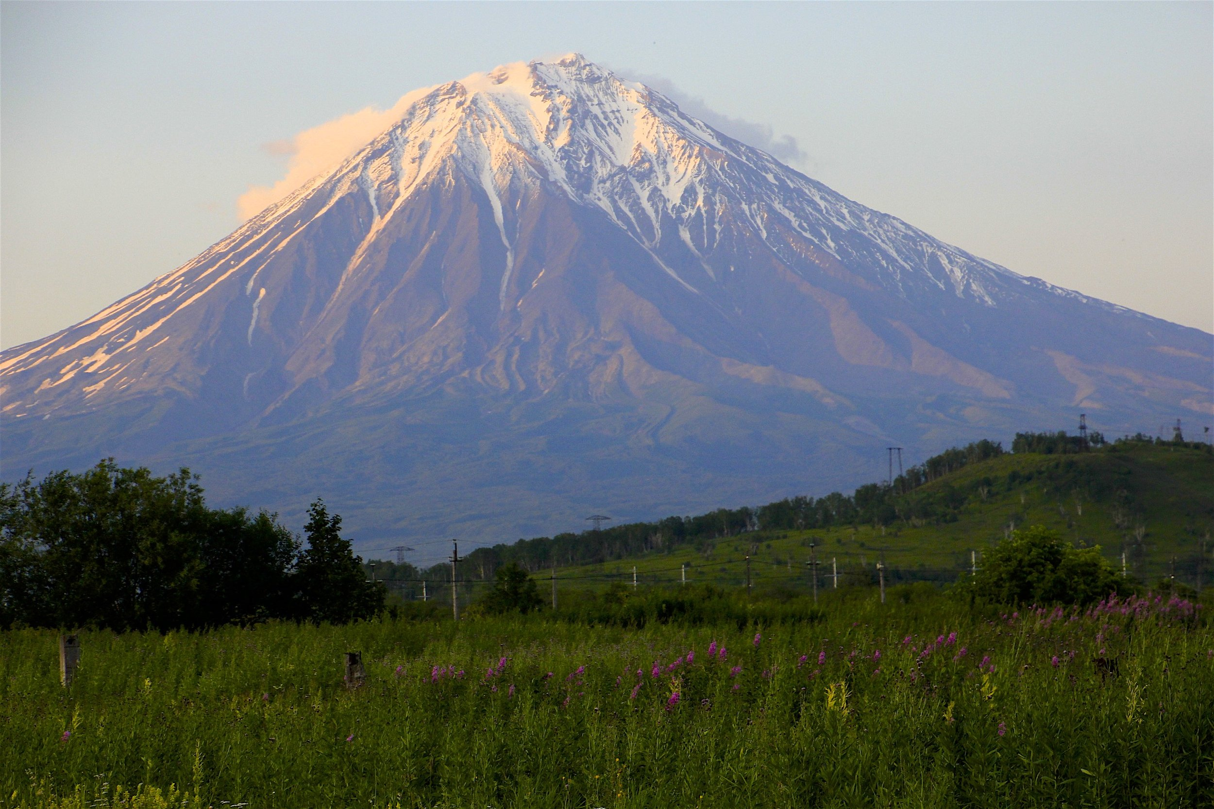 The Koryaksky Volcano near Petropawlowsk Kamchatsky (PK). It is 3,456m high. It belongs to the Avachinskaya group of Volcanoes. It had a small eruption of ash in 2009 forcing landing aircraft to change course. the upper part has a 35 degree slope and some exposed rocky sections.