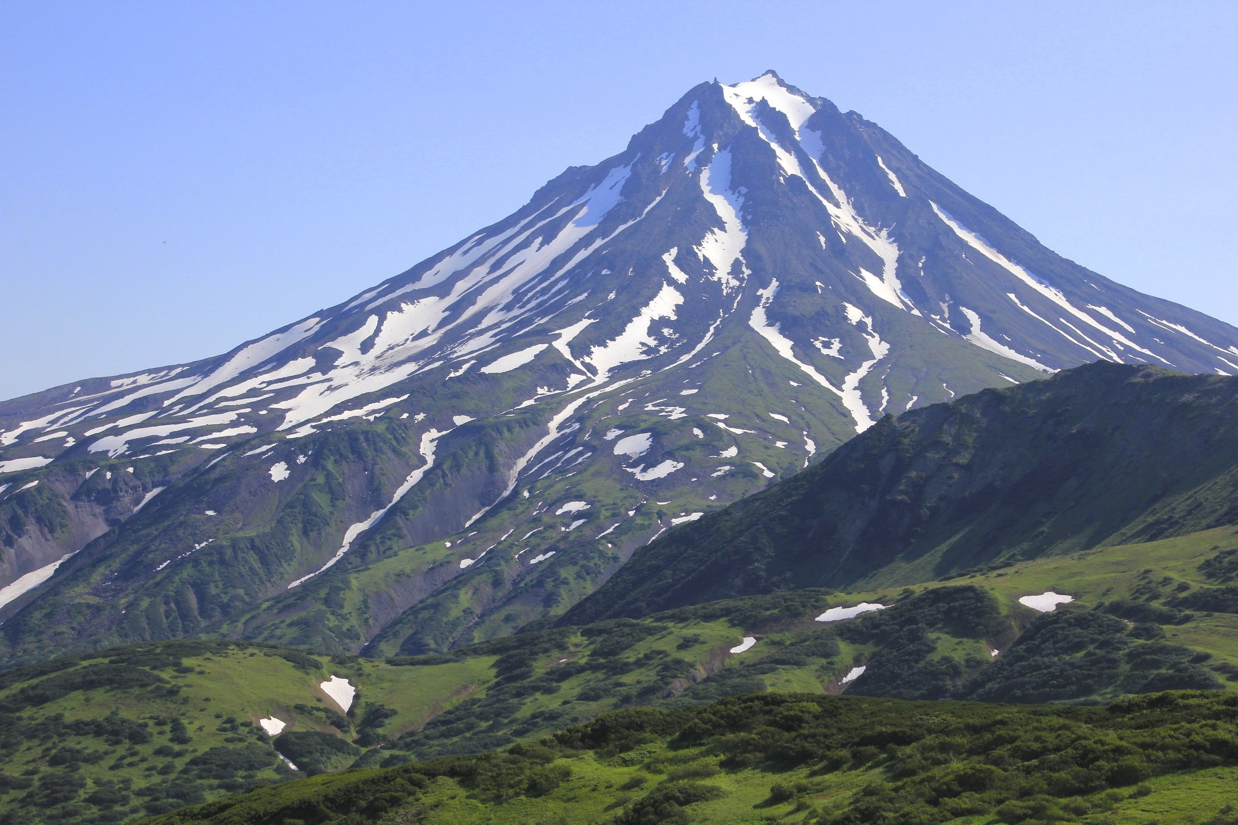 The Vilyuchinsky Volcano 2,173m. It is 1.5 hr away from PK by car on a so-so road. The sign at its base indicated that it required 6 hours for an ascent.