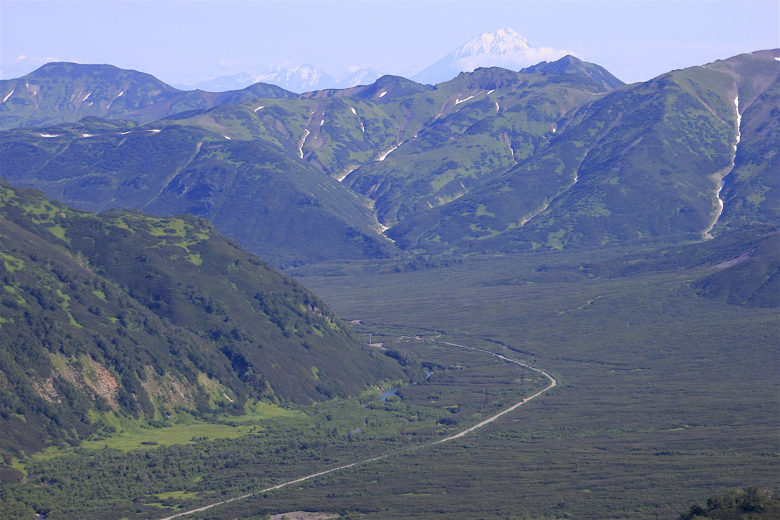 The road from PK to The Plateau of the Mutnovsky Volcano. The area of the Mutnovsky Volcano is located about 70km south from PK and is on the edge of the Mutnovsky National Park. The volcanic plateau is 600 to 900m high where cones of active volcanoes tower above the alpine tundra, free of snow only for three months of the year. There are three volcanoes in the area: the active Muntovsky and Gorely and the dormant Vilyuchinsky. The area receives over 15m of snow in winter! The road is not muddy but very rocky and dusty,