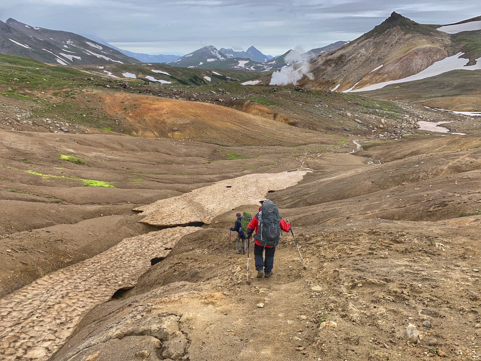 Hiking from the Mutnovsky Volcano to the Mutnovskaya Geothermal Station.