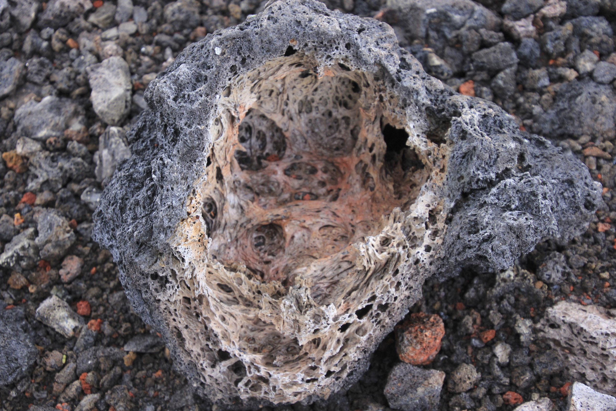 Inside a volcanic bomb the lava is like a frozen sticky glue but hard like a rock.