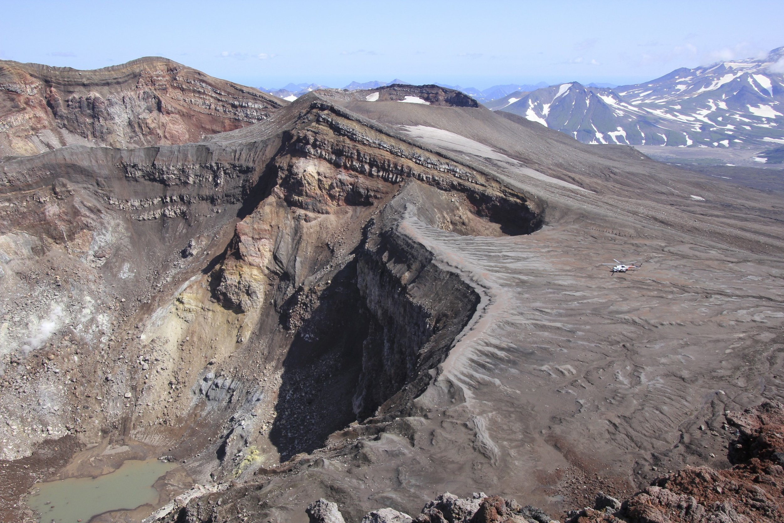 The Mi8 helicopter parked at the rim of the active crater on Gorely Volcano.