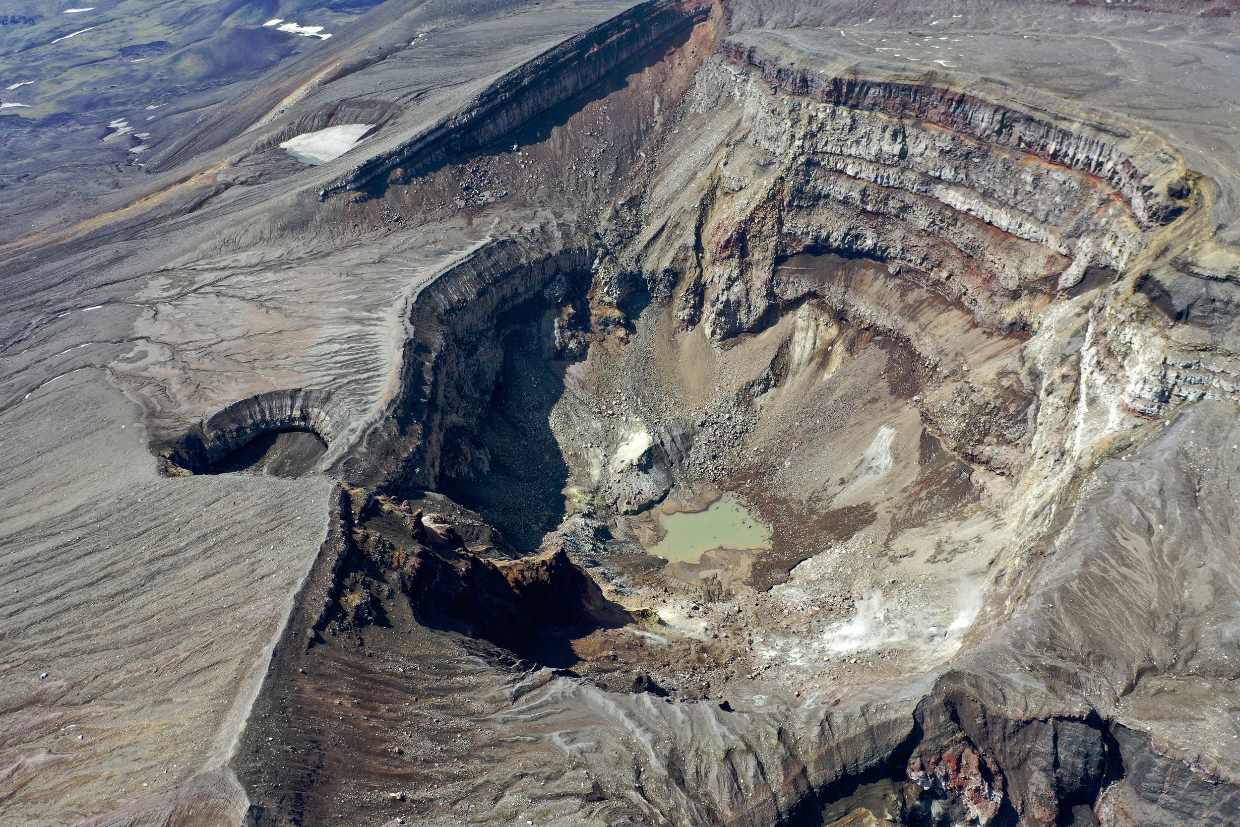 The active crater of the Gorely Volcano with the active gas vent on the lower right side. The gas vent has a temperature of 900C. The activity began in 2010 and is still ongoing. The drone photo by Evgeny Androssov.