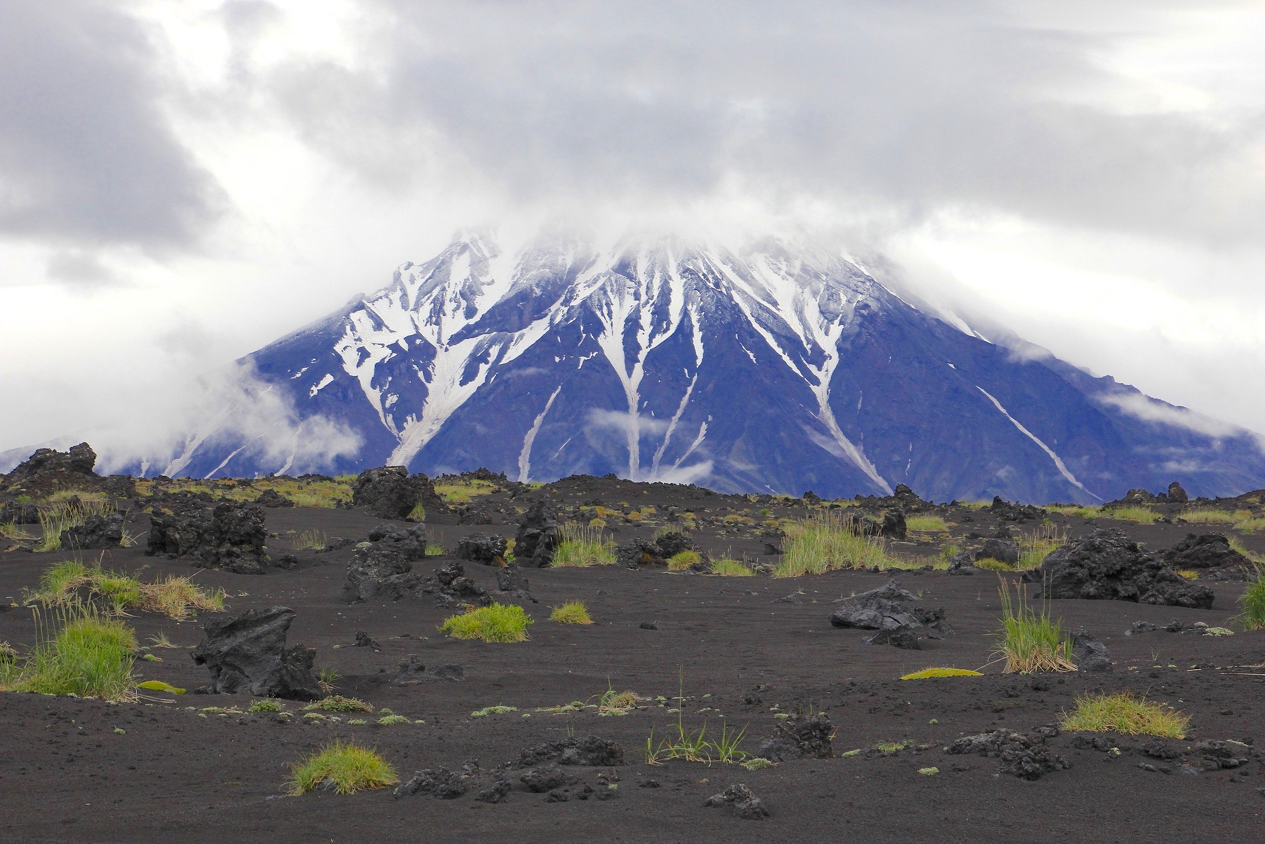 The Udina Volcano and the black soil of the Tolbachik lava fields.