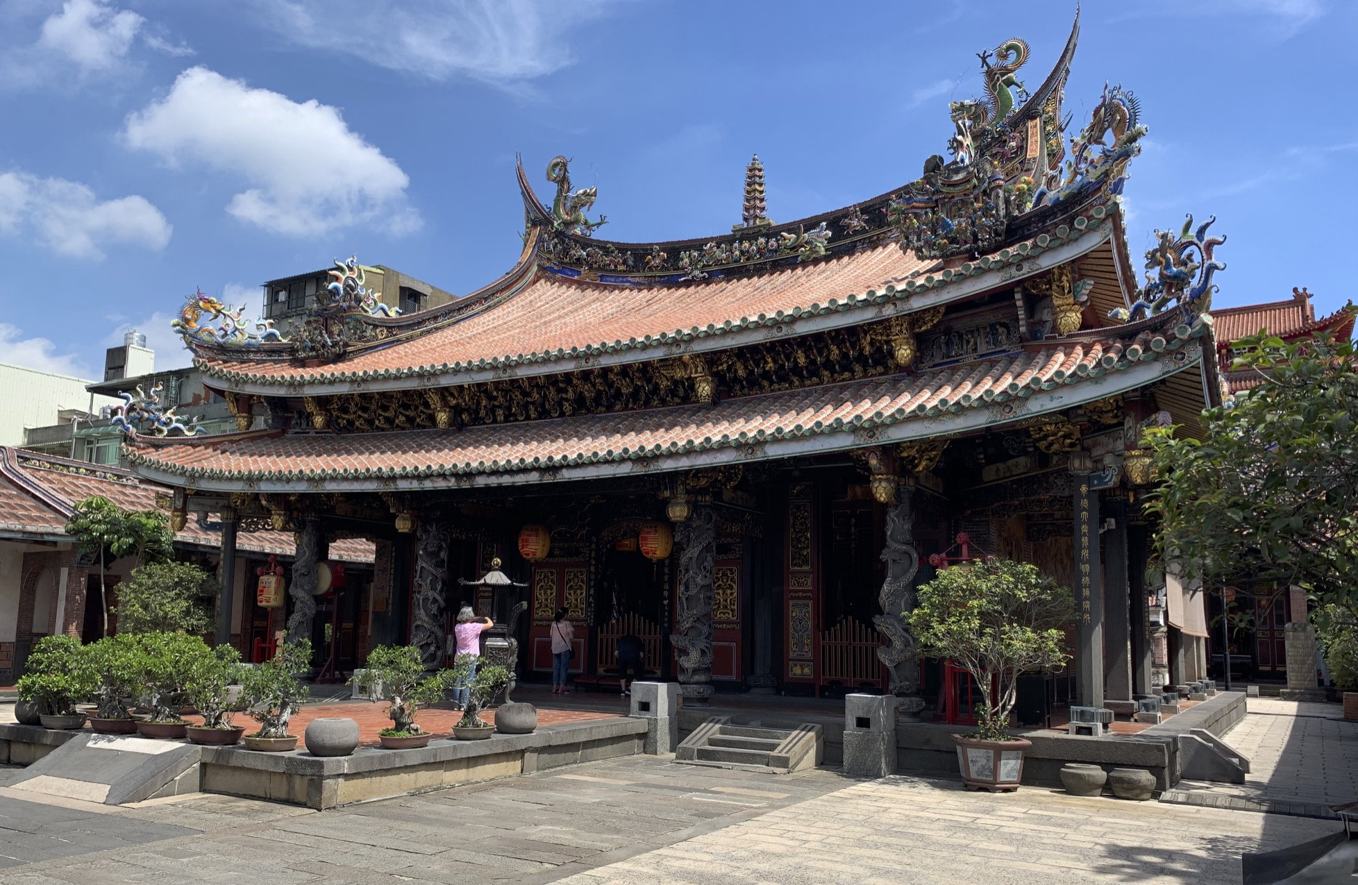 Originally constructed in 1742 as a wooden shrine, the Bao'an Temple is a Taiwanese folk religion temple. Throughout Taiwan's history, the temple was renovated and reconstructed numerous times, leading to a 2003 induction into UNESCO for cultural heritage conservation.  Dedicated to the Taoist saint  Baosheng Dadi (保生大帝) , the 900 SQ METRE large temple faces south, in line with Feng-Shui practices, and houses the front, main, and rear halls, along with the east and west halls. The buildings also run from tallest to shortest in that order, in observance of Confucian principles. The temple also houses a drum tower.  Important architectural elements around the temple grounds include stone carvings, stone lions, dragon columns, stone bamboo windows, and wood, stone, and clay carvings.