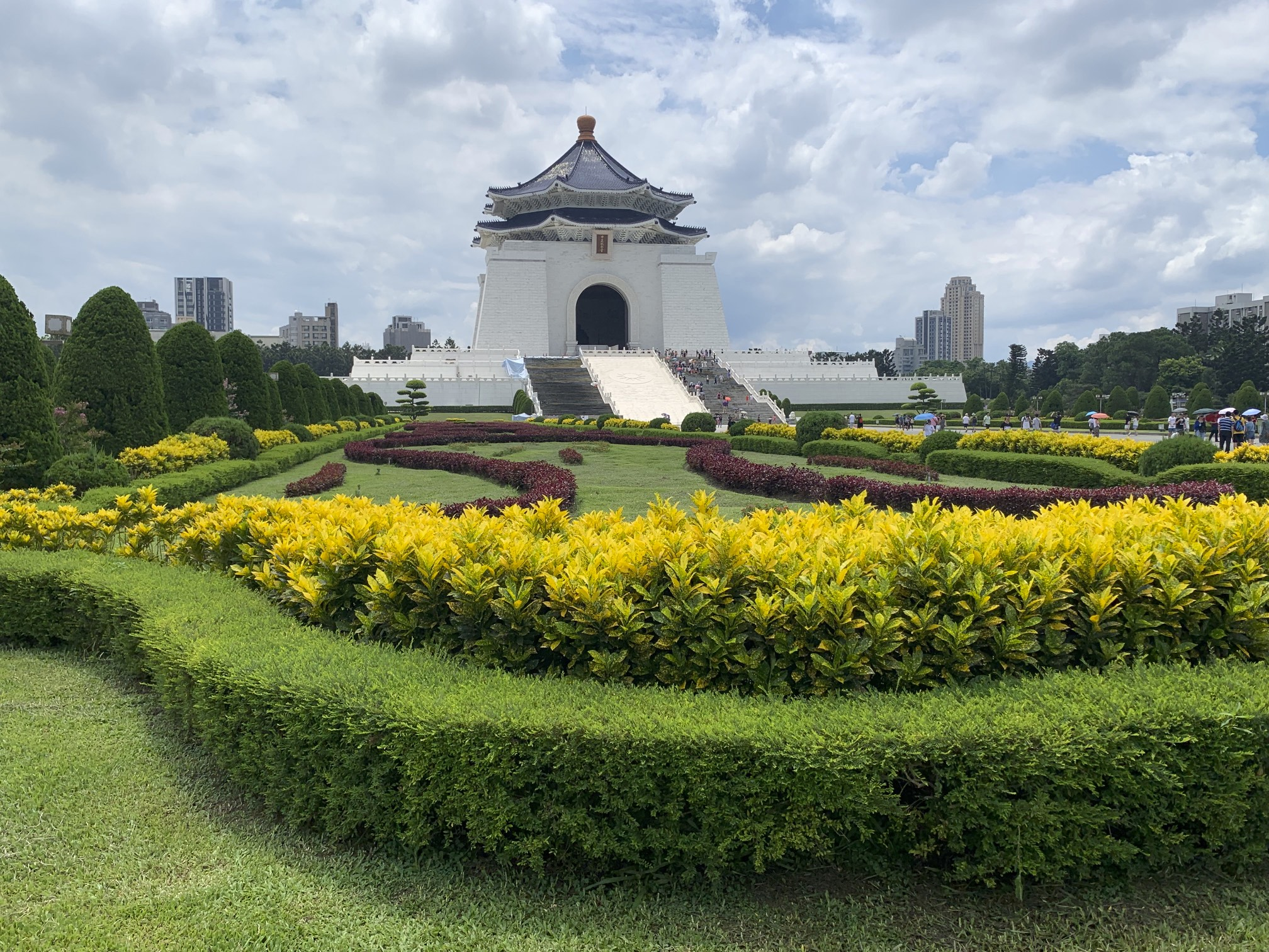 "The most prominent historical landmark in Taiwan, the CKS Memorial Hall was erected in honor and memory of Generalissimo Chiang Kai-shek, the former President of the Republic of China, and was opened in 1980 as part of a national park and gathering area. The characters behind Chiang's statue read ""Ethics"", ""Democracy"", and ""Science"", and the inscriptions on the side read ""The purpose of life is to improve the general life of humanity"" and ""The meaning of life is to create and sustain subsequent lives in the universe""."