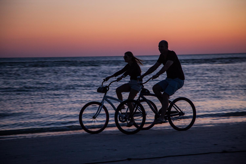 Romantic bike rides at sunset.