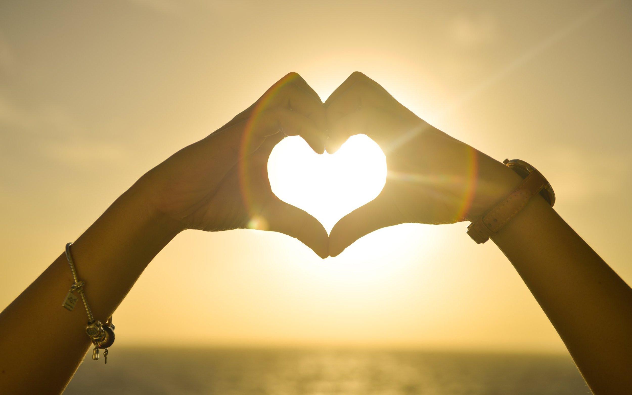 couple-making-heart-shape-wide-2.jpg