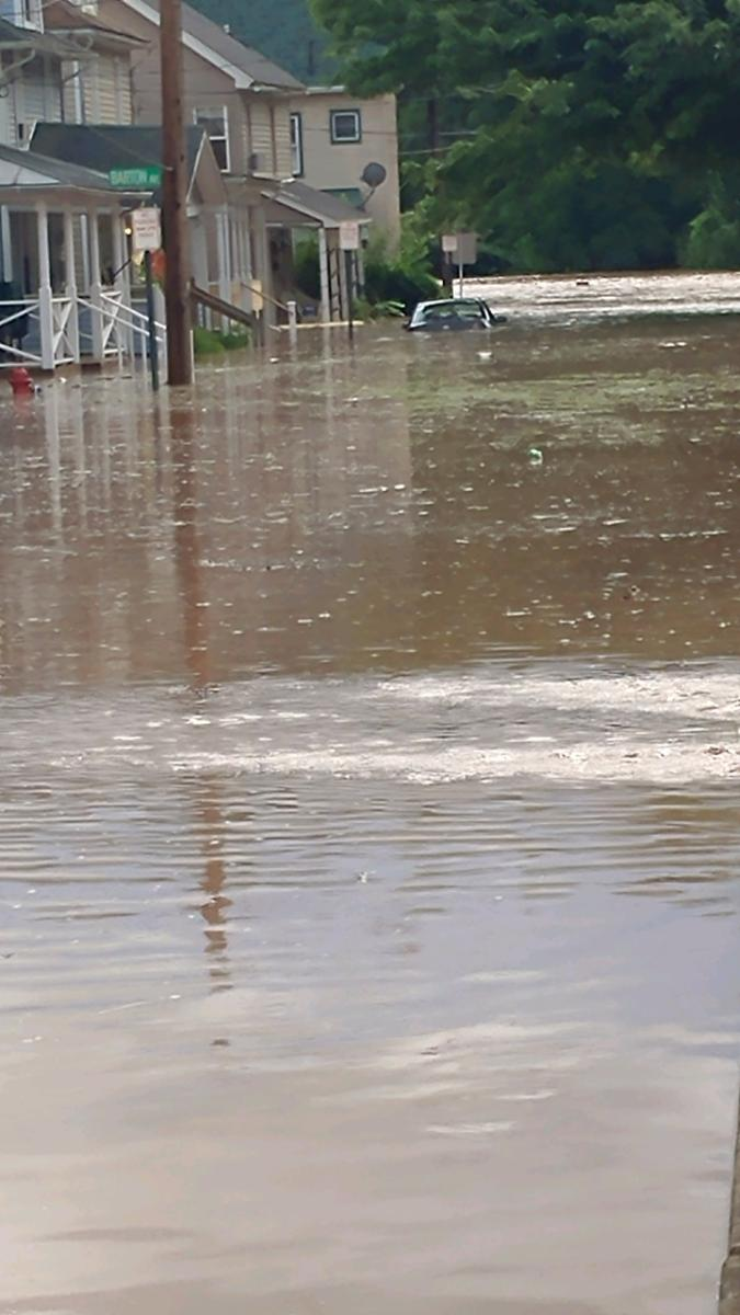 A car is seen partially submerged in Bloomsburg Monday afternoon, courtesy of Valeri Reynolds