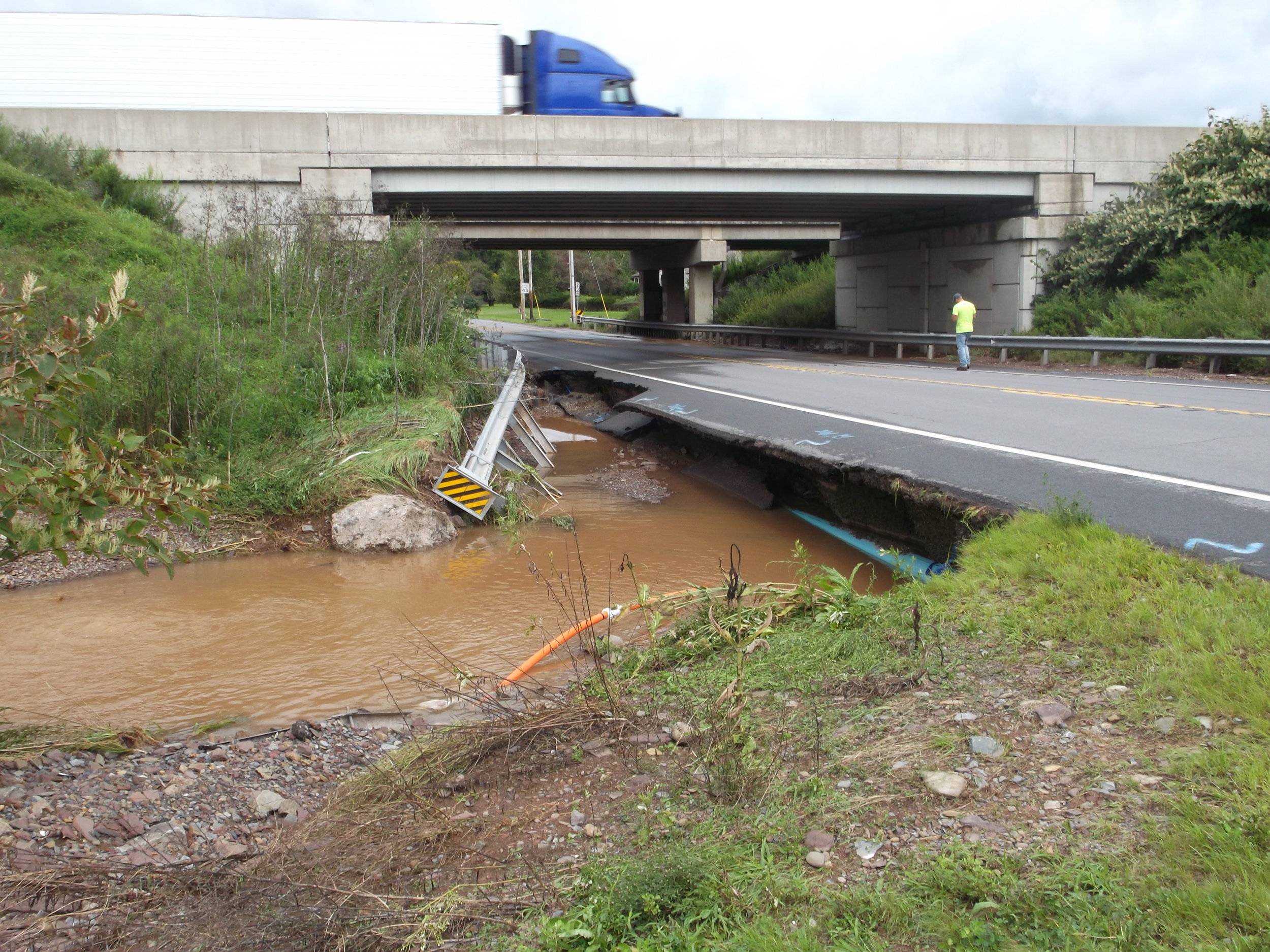 Road bed washed out along Millville Road in Bloomsburg, near I-80
