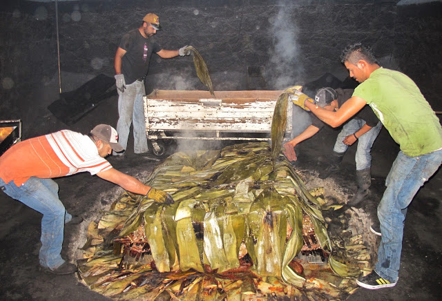 Meat is roasted in a pit dug into the earth, fueled by wood and covered in 'pencas' of maguey, the plant from which mezcal is produced