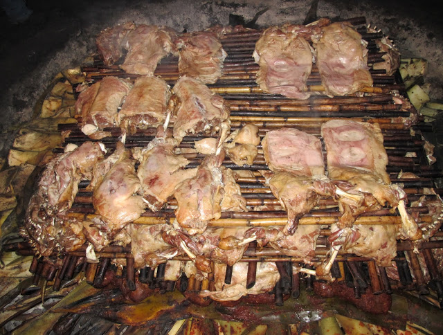 bamboo poles support roasted meat