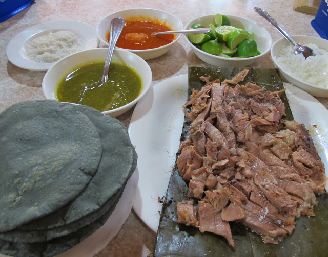 At the table; two salsas, limes, onion and coarse salt