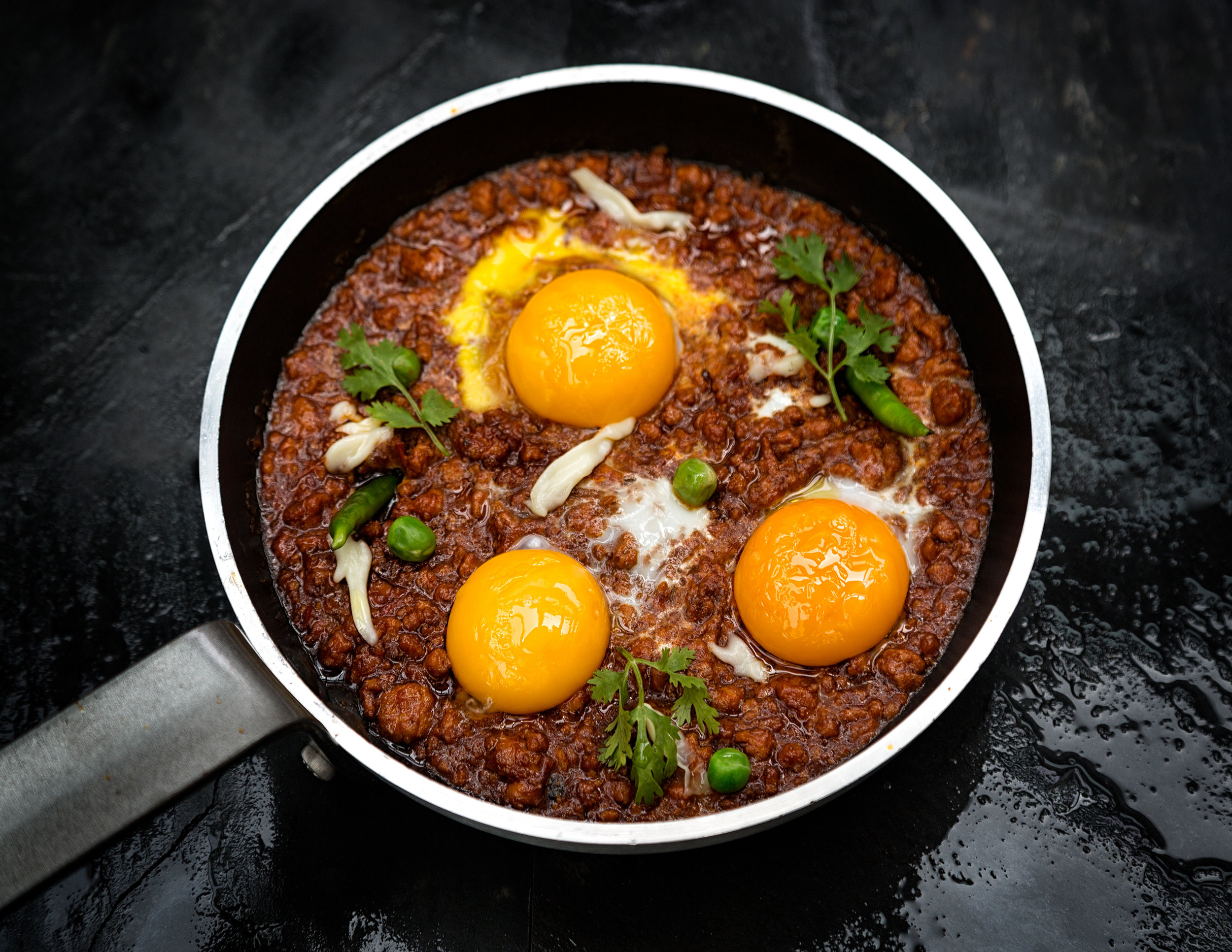 Chicken Chilli, dabba gosht, baked Egg, Chappati, Image by Rohit Chawla for Indian Accent