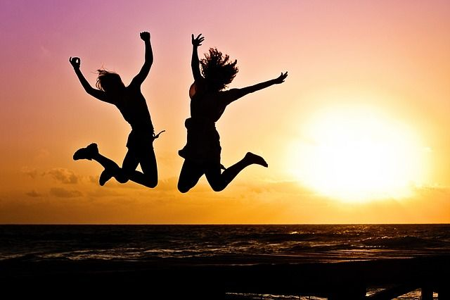 Girls Jumping During Sunset