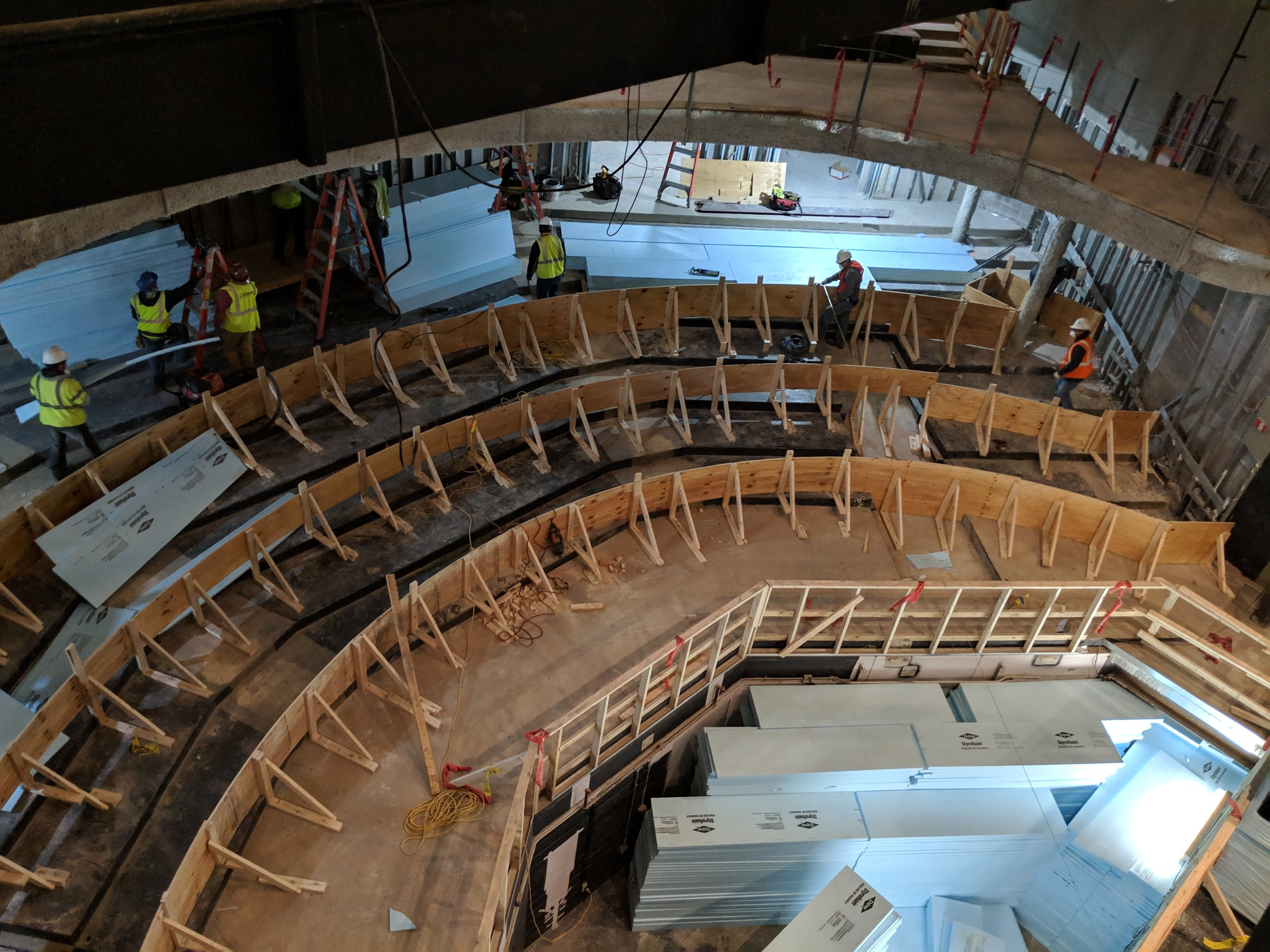April 2019  - Workers prepare for concrete to be poured in the theatre, forming the new curved seating in the orchestra.