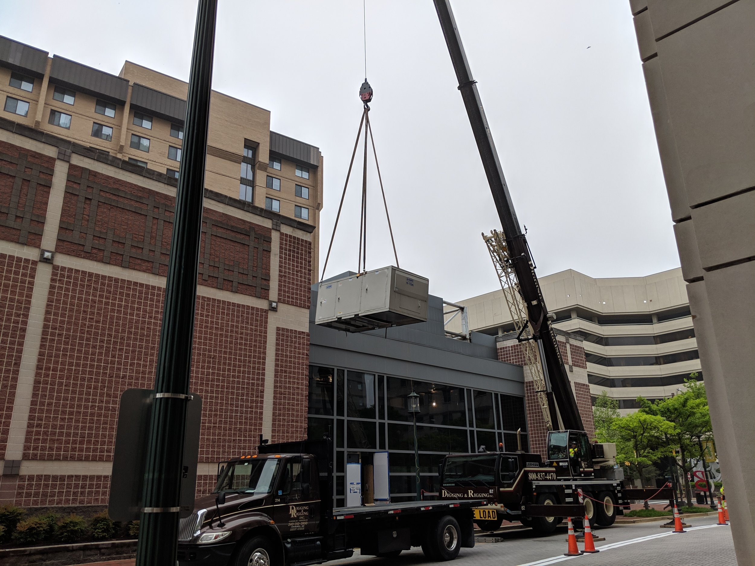 May 2019  - Our new HVAC system en route to the roof for installation!