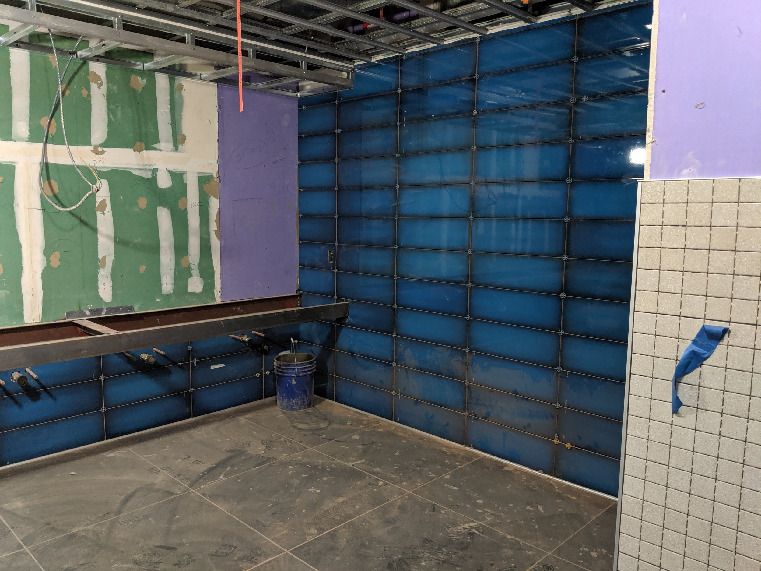 June 2019  - Our restrooms are getting a full remodel, with new fixtures, flooring, and tiled walls like the rich blue color you see here. The men's restroom entrance will be relocated to behind concessions to alleviate traffic near the women's restroom entrance.
