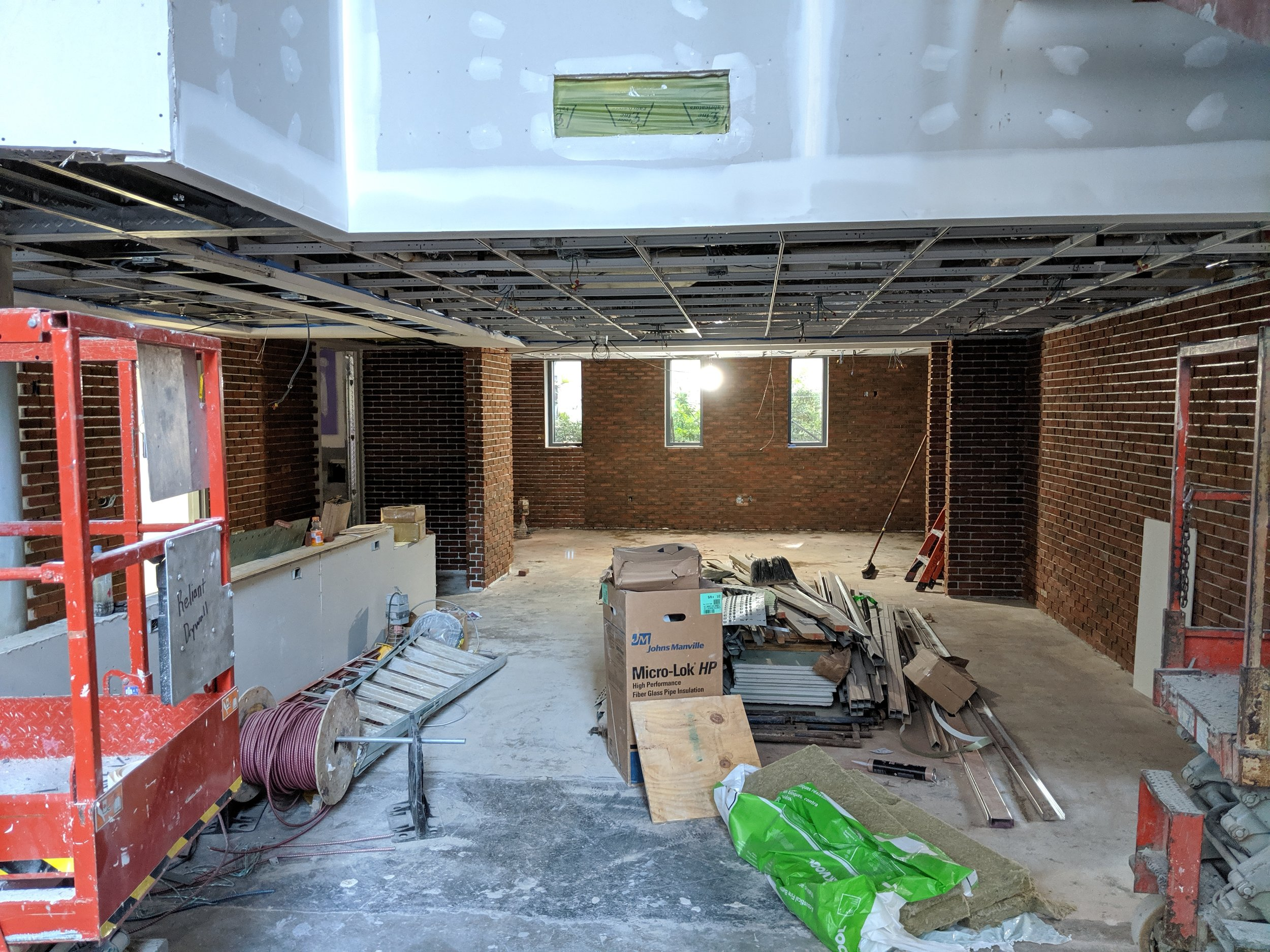 June 2019  - Brick will be featured throughout the theatre and lobby, as you see here. Where our Patrons Lounge used to be is now an open space with additional seating for patrons to enjoy a drink or food from our café before and after performances.