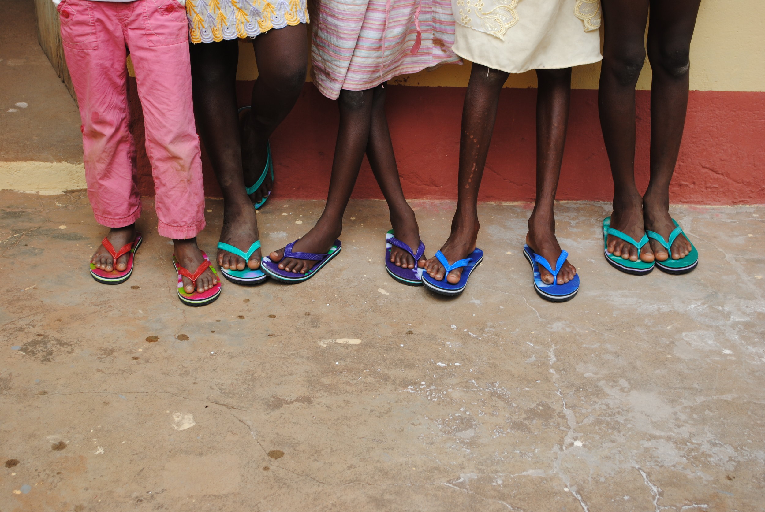 You can probably tell that the few clothes they had were ill-fitting and in bad shape. One of the first things Celestine did was bring over new shoes and have the girls fitted for Sunday dresses by a seamstress.