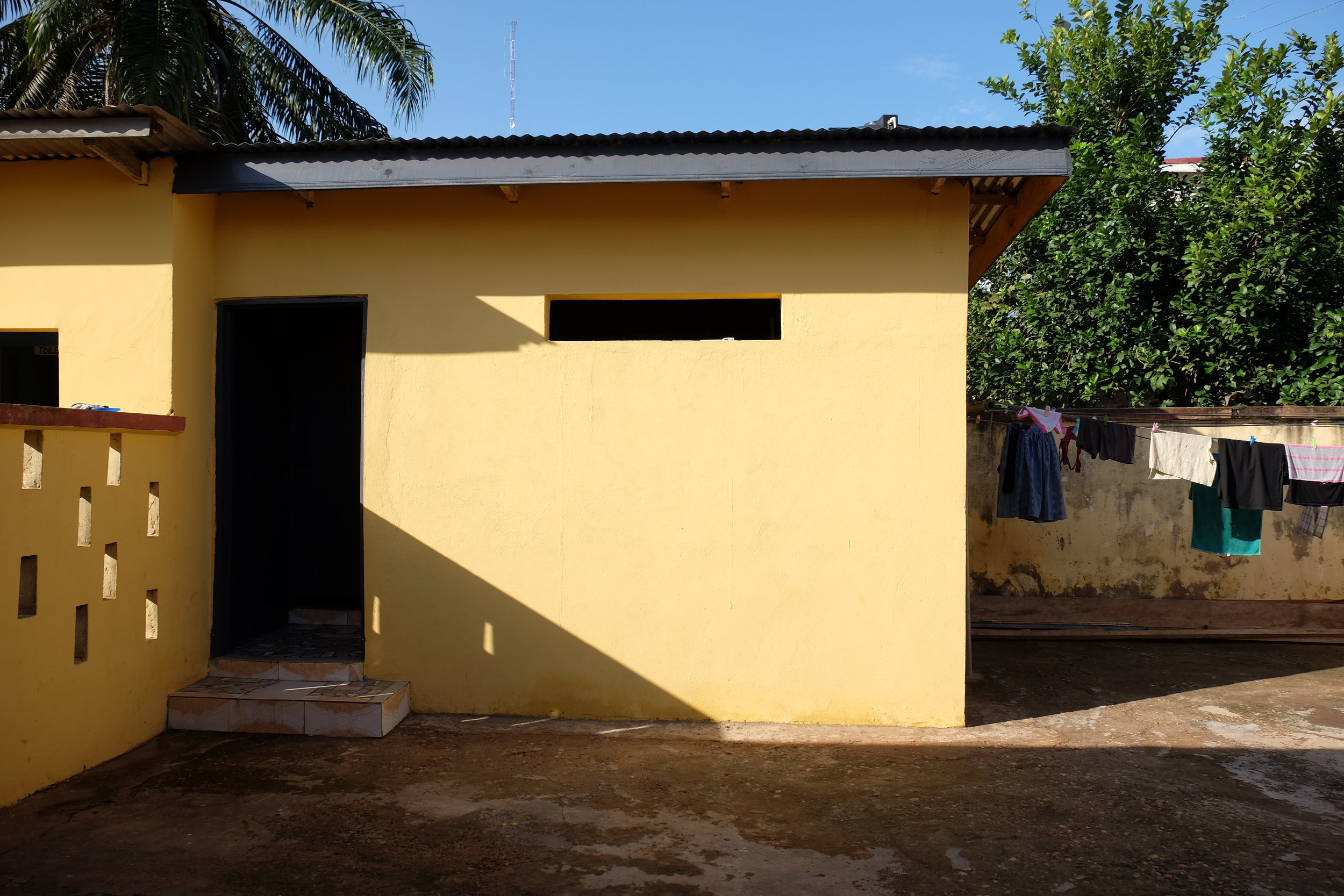 The house has seen some much-needed improvements. This structure was added on to the right of the existing bathroom with two new showers and toilets.