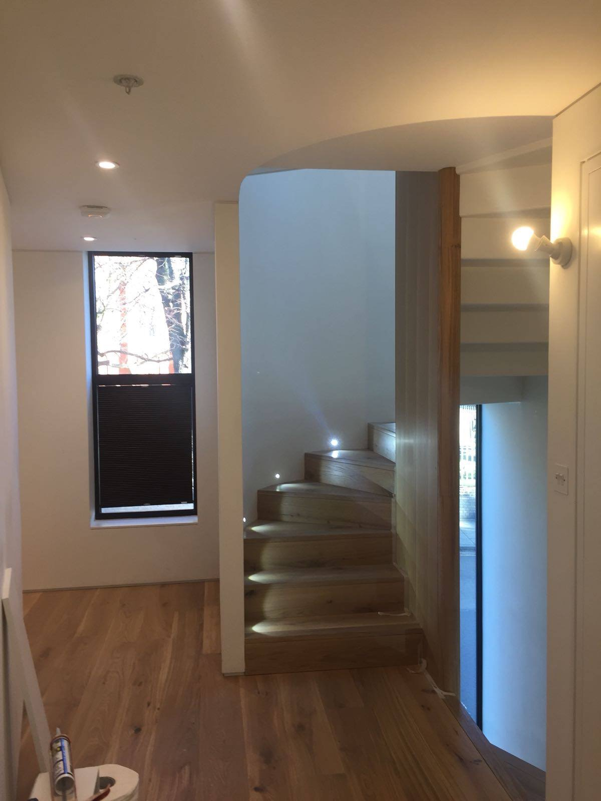 A spiral staircase with detailed finishing  |  Refurbishment, London
