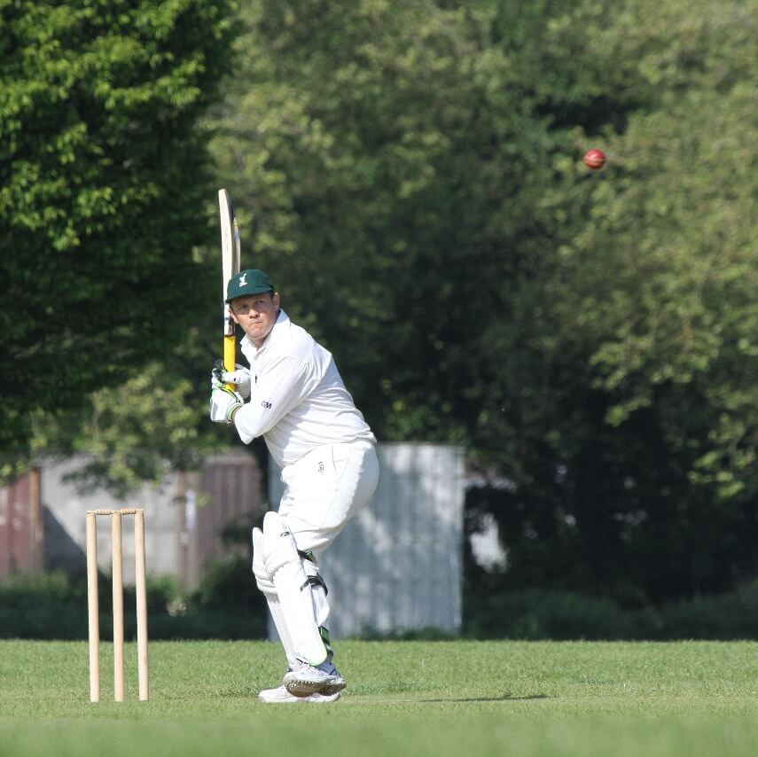 Batsman playing for local community cricket team, 'The Racqueteers'