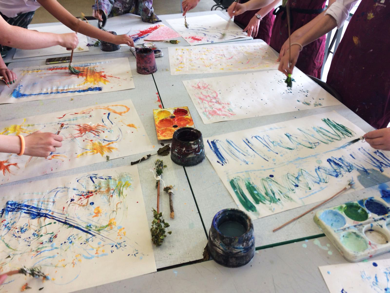 Creating collaborative, abstract paintings with handmade, natural paintbrushes.